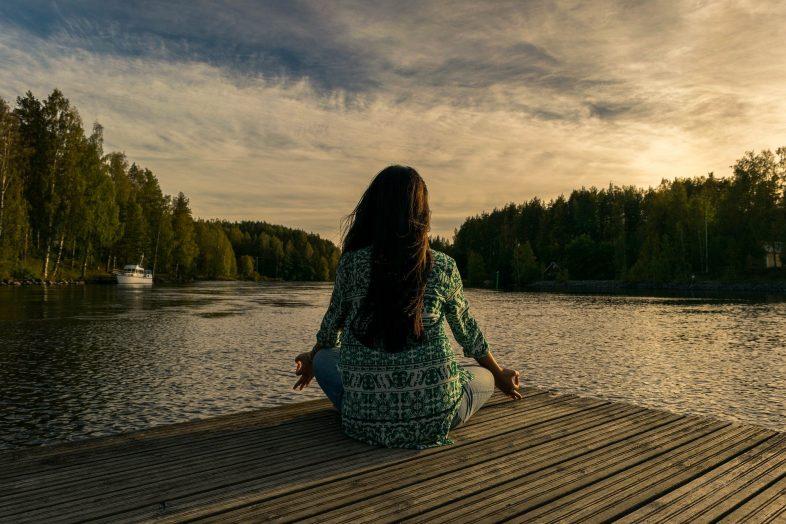 woman meditation trees